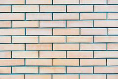 Background of light coloured red painted brick wall pattern texture.  royalty free stock photography