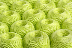 Background light green yarn. Texture of colored yarn skeins stock photos