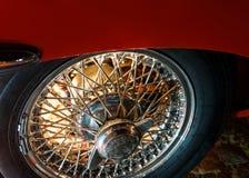Background light illuminating wheel of a vintage car royalty free stock image