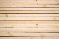 Background of light planks of pine, covered with protective varnish. stock image