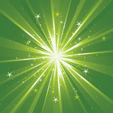 Background with light rays and stars. Green background with light rays and stars Stock Image