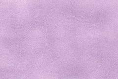 Background of light violet suede fabric closeup. Velvet matt texture of lilac nubuck textile Stock Image