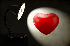 Background with lighting desk lamp and heart Stock Photography