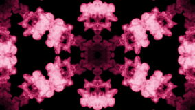 Background like Rorschach inkblot. Fluorescent pink ink or smoke, isolated on black in slow motion. Pink colour stock footage