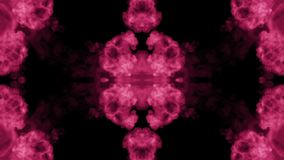 Background like Rorschach inkblot test2. Fluorescent pink ink or smoke, isolated on black in slow motion. Color drop in stock video