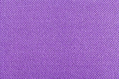 Background of lilac fabric, texture of the material, close up. Lilac background  of fabric, one color,  texture of the material, place for text Royalty Free Stock Image