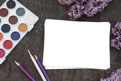 Spring Background in lilac tones with white sheet of paper for writing greetings or notes royalty free stock photos