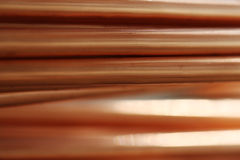 Background line of copper pipes Stock Photography
