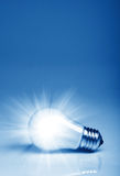Background with lit lightbulb Stock Image