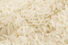 The background of long-grain rice Royalty Free Stock Images