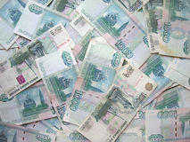 The background - is a lot of banknotes of Russia Stock Images