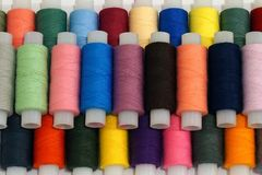 Many reels with multi-colored thread for sewing royalty free stock photo