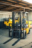 Background of a lot of forklifts, reliable heavy loader, truck. Heavy duty equipment, forklift Stock Images