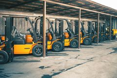 Background of a lot of forklifts, reliable heavy loader, truck. Heavy duty equipment, forklift Stock Photo