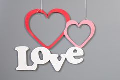 Background for love and romance. On grey two hearts and text Royalty Free Stock Photography