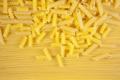 Background of Macaroni on long spaghetti. Royalty Free Stock Photos