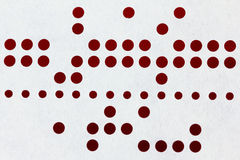 Background macro of perforated punched tape Stock Photo