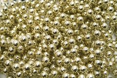 Background made of a brilliant celebratory beads. Of golden color Royalty Free Stock Images