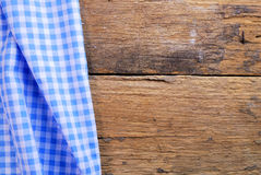 The background made from checkered napkin on old wooden table Royalty Free Stock Image