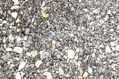 Background made of a closeup of a pile of pebbles royalty free stock photo