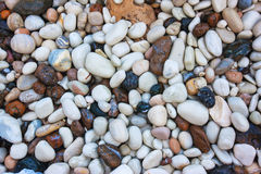 Background made of a closeup of a pile of pebbles Stock Image