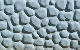 Background made of a closeup of a wall with pebbles Royalty Free Stock Photos