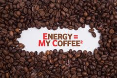 Background made of coffee beans in a heart shape with message `ENERGY = MY COFFE2` Stock Images