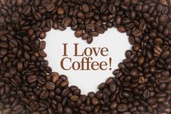 Background made of coffee beans in a heart shape with message `I Love Coffee!` royalty free stock photos