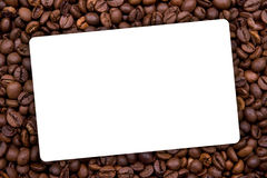 Background made with coffee beans with white label Stock Image