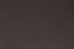 Background made of dark brown leather. Macro picture made of leather imitade Royalty Free Stock Image