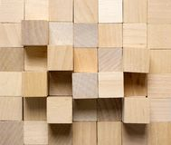 Background made from different wooden cubes stock images