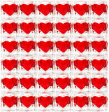 Background made of glass tiles with hearts. Background made of glass tiles with red hearts Stock Image