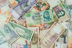 Background made of international money bills / banknotes stock photography