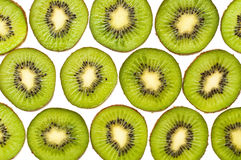 Background made of kiwi slices isolated on white Royalty Free Stock Photos