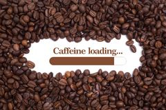 Free Background Made Of Coffee Beans With A Loading Bar And Message `Caffeine Loading...` Royalty Free Stock Image - 82338546
