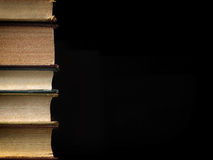 Background made of old books arranged in stacks. Concept background made of old books arranged in well-ordered close stacks stock images