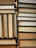 Background made of old books arranged in stacks. Concept background made of old books arranged in well-ordered close stacks royalty free stock photos