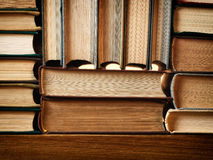 Background made of old books arranged in stacks Royalty Free Stock Images