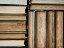Background made of old books arranged in stacks. Concept background made of old books arranged in well-ordered close stacks royalty free stock photography