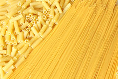 Background made from pasta. A lot of pasta. Background made from spaghetti and penne. Isolated on white Stock Images