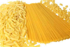 Background made from pasta. A lot of pasta. Background made from spaghetti and penne. Isolated on white Royalty Free Stock Image