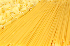 Background made from pasta. A lot of pasta. Background made from spaghetti and penne. Isolated on white Stock Image