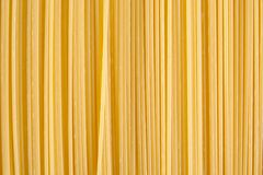 Background made of raw pasta stacked vertically Royalty Free Stock Photos