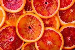 Background made of ripe juicy blood orange slices. Royalty Free Stock Image