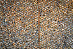 Background made from rusty metal mesh cage  stone Stock Photography