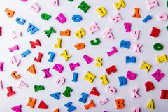 Scattered colorful wooden letters. Background made of scattered colorful wooden letters on white background Stock Photography