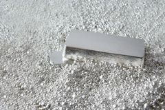 silver brick in pieces of silver stock image