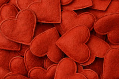 Heart Background. Background made of small felt hearts Royalty Free Stock Photos