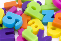 Background of magnetic letters. Close up background of multicolored magnetic letters Royalty Free Stock Images