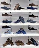 Background with shoes on shelves of shop Royalty Free Stock Images